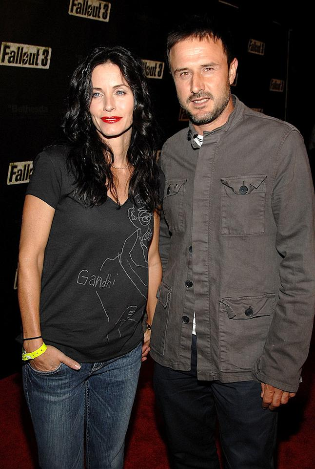 "Who knew that Courteney Cox Arquette and husband David were such video game fanatics? John Shearer/<a href=""http://www.wireimage.com"" target=""new"">WireImage.com</a> - October 16, 2008"