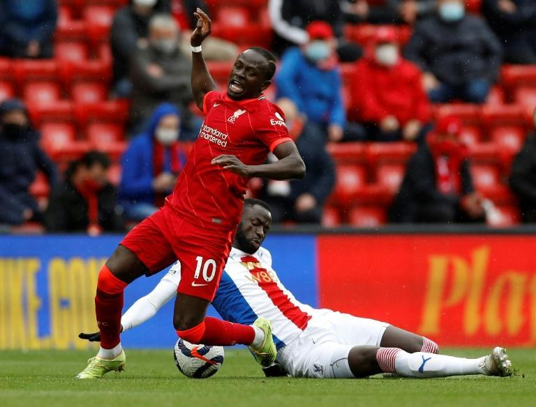 Liverpool forward Sadio Mane (L) is fouled by Crystal Palace midfielder and fellow Senegalese Cheikhou Kouyate at Anfield.