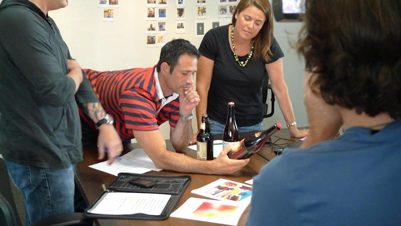 Sam and Mariah Calagione discuss the Bitches Brew label with Dave Kammerrandier in August 2013.