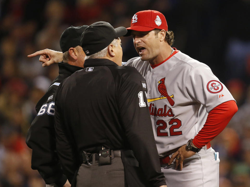 St. Louis Cardinals manager Mike Matheny argues a call during the first inning of Game 1 of baseball's World Series against the Boston Red Sox Wednesday, Oct. 23, 2013, in Boston. (AP Photo/Elise Amendola)
