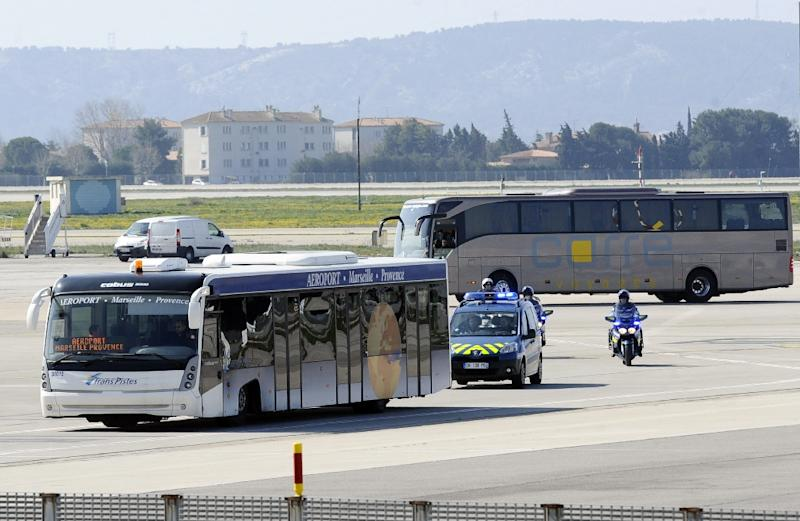 Buses carrying family members of the victims of the Germanwings plane crash are escorted by police in Marignane on March 26, 2015 before heading to the area of the crash in the Alps (AFP Photo/Franck Pennant)