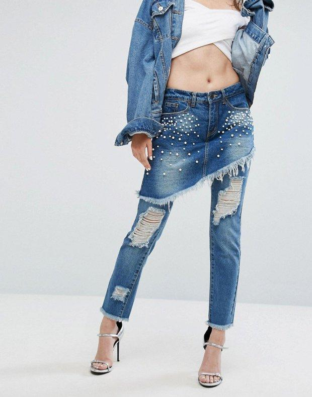 """<p>Remember when everyone wore skirts over trousers in the late 90s? Well that trend's back – with a denim twist. ASOS retailer <a rel=""""nofollow noopener"""" href=""""http://www.asos.com/liquor-n-poker/liquor-n-poker-denim-skirt-over-jeans-with-pearl-detail/prd/8304714?affid=14173&channelref=product+search&mk=abc¤cyid=1&ppcadref=761030383%7C49292461327%7Caud-305235869460%3Apla-348732224811&_cclid=v3_ef1101a9-211b-5f2c-a87e-8316587261e5&gclid=CjwKCAjwrO_MBRBxEiwAYJnDLIxwyP_Gf30mGzb_C9v3tVb3aDYjncdGv5L2YGY8vPC8NO7LnGtSrBoC9VUQAvD_BwE&affid=10607&pubref=1171&transaction_id=102de3d48b4ac68fbfeb7e80a4021a&affid=10607&pubref=1171&transaction_id=102357b4392c7797bf6735aa6c7ea5"""" target=""""_blank"""" data-ylk=""""slk:Liquid N Poker Denim"""" class=""""link rapid-noclick-resp"""">Liquid N Poker Denim</a> is selling a bizarre A-symmetric denim skirt (covered in faux pearls, we must add) that's sewn on top of a distressed pair of jeans. Yikes. <br><em>[Photo: ASOS]</em> </p>"""