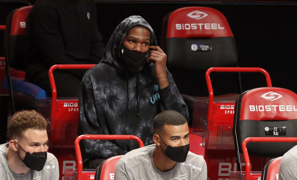 NEW YORK, NEW YORK - MARCH 21: (NEW YORK DAILIES OUT)  Kevin Durant #7 of the Brooklyn Nets looks on against the Washington Wizards at Barclays Center on March 21, 2021 in New York City. The Nets defeated the Wizards 113-106. NOTE TO USER: User expressly acknowledges and agrees that, by downloading and or using this photograph, User is consenting to the terms and conditions of the Getty Images License Agreement. (Photo by Jim McIsaac/Getty Images)