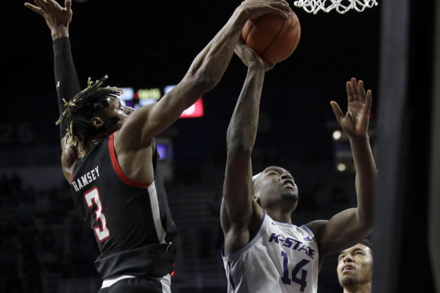 Texas Tech guard Jahmi'us Ramsey (3) blocks a shot by Kansas State forward Makol Mawien (14) during the second half of an NCAA college basketball game in Manhattan, Kan., Tuesday, Jan. 14, 2020. (AP Photo/Orlin Wagner)