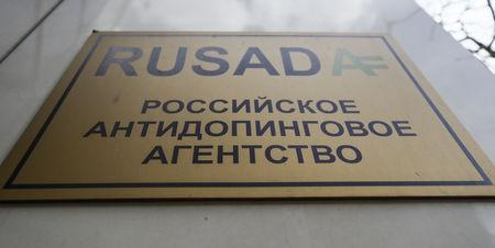 FILE PHOTO: A sign is on display outside the office of Russian Anti-Doping Agency (RUSADA) in Moscow, Russia March 28, 2018. Picture taken March 28, 2018. REUTERS/Maxim Shemetov