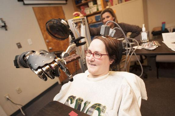 Quadriplegic Woman Moves Robot Arm With Her Mind