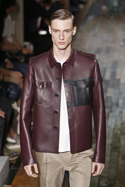 A model wears a creation by fashion designers Maria Grazia Chiuri and Pier Paolo Piccioli for Valentino, as part of their presentation for the men's fashion Spring-Summer 2014 collection, presented Wednesday, June 26, 2013 in Paris. (AP Photo/Francois Mori)