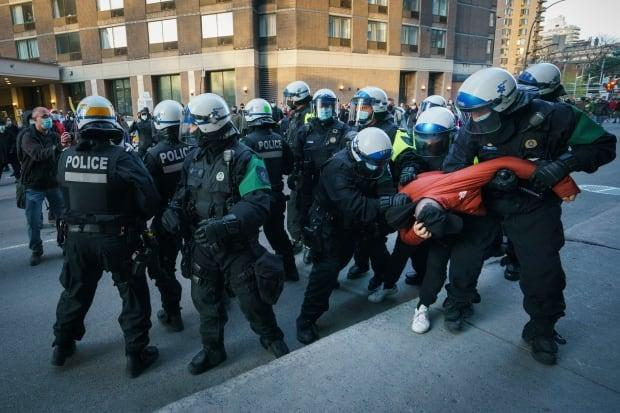 Dozens of Montreal police officers followed protesters Sunday.