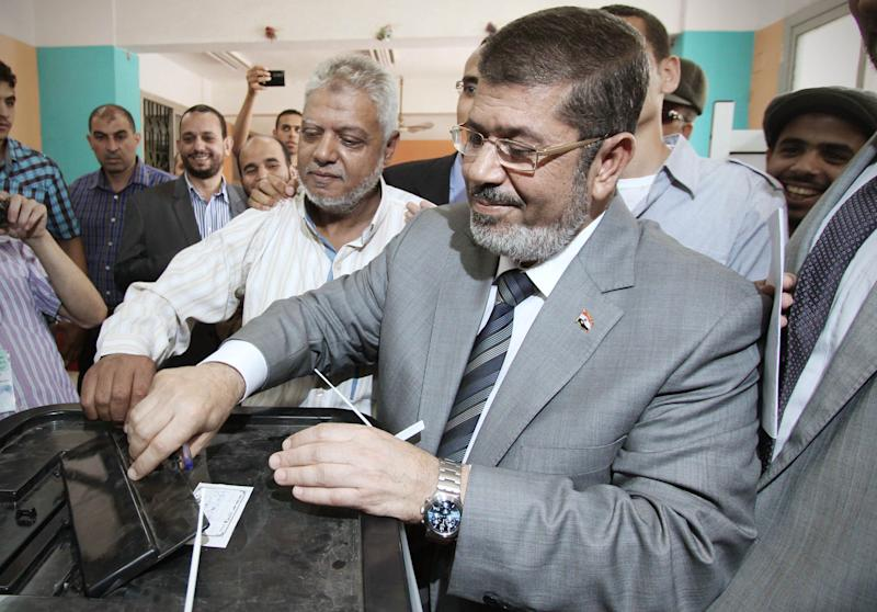 Egyptian Muslim Brotherhood presidential candidate Mohammed Morsi, casts his vote inside a polling station, in Zakazik 80 Kilometers (50 miles) north of Cairo, Egypt, Wednesday, May 23, 2012. On Wednesday morning, Egypt commenced two days of presidential voting after 16 months of interim rule by the Supreme Council of Armed Forces. This election is the first free and fair race since the ouster of former President Hosni Mubarak. (AP Photo/Ahmed Gomaa)