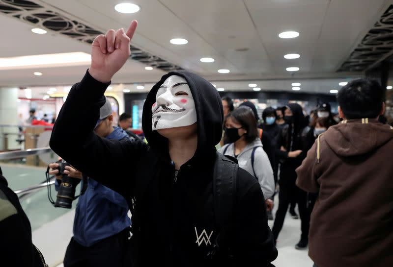 Anti-government demonstrators protest in Sheung Shui shopping mall in Hong Kong