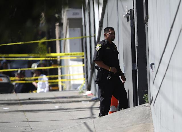 <p>A San Francisco sheriff deputy stands guard at the scene of a shooting at a UPS facility on June 14, 2017 in San Francisco, California. (Justin Sullivan/Getty Images) </p>