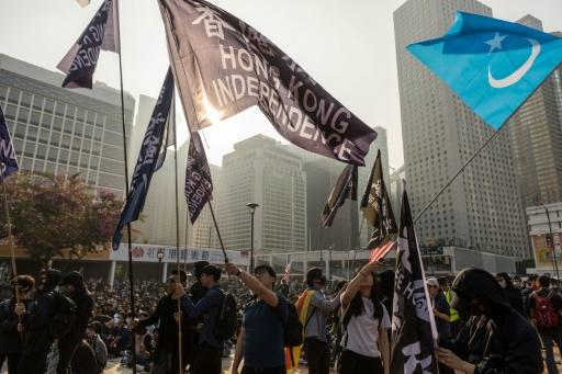 Protesters in Hong Kong gathered to listen to speeches warning of the Chinese Communist Party's crackdown in Xinjiang