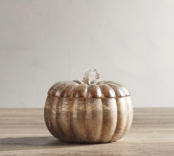 <p>The shimmery <span>Mercury Lidded Pumpkin Candle Pot</span> ($50-$69) accents any surface wonderfully.</p>
