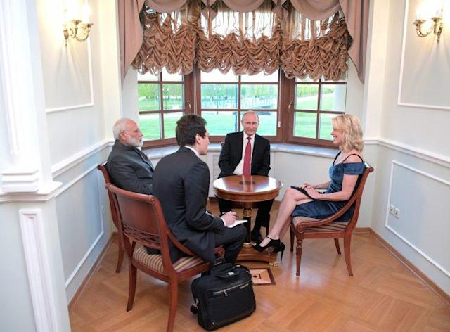 Megyn Kelly meets with Indian Prime Minister Narendra Modi and Russian President Vladimir Putin before the St. Petersburg International Economic Forum. (Photo: Alexei Druzhinin, Sputnik, Kremlin Pool Photo via AP)