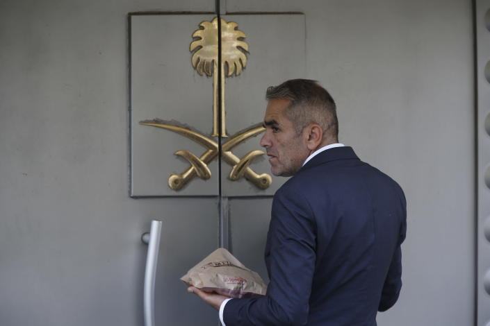 A security guard waits to enter Saudi Arabia's consulate in Istanbul, Wednesday, Oct. 10, 2018. Turkish officials have said they believe Saudi writer and government critic Jamal Khashoggi, was killed inside the consulate after he visited the mission to obtain a document required to marry his Turkish fiancee. Saudi Arabia has denied the allegations. (AP Photo/Lefteris Pitarakis)