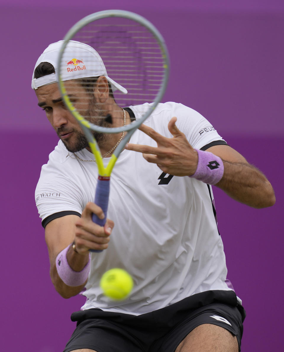 Matteo Berrettini of Italy plays a return to Andy Murray of Britain during their singles tennis match at the Queen's Club tournament in London, Thursday, June 17, 2021. (AP Photo/Kirsty Wigglesworth)