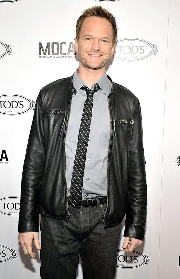 "Neil Patrick Harris does a fab job playing smooth-talking, designer suit-wearing womanizer Barney on TV's ""How I Met Your Mother,"" but off-camera he's one of many celebs who are openly gay. Toby Canham/<a href=""http://www.gettyimages.com/"" target=""new"">GettyImages.com</a> - April 15, 2010"