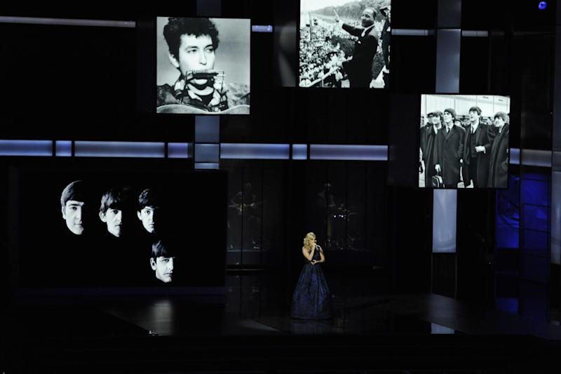 """Carrie Underwood performs """"Yesterday"""" by the Beatles at the 65th Primetime Emmy Awards at Nokia Theatre on Sunday Sept. 22, 2013, in Los Angeles. (Photo by Chris Pizzello/Invision/AP)"""