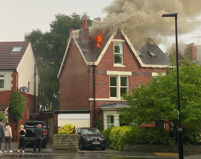 A house in Sheffield caught fire after being struck by lightning. (James Pierce/Twitter/PA)
