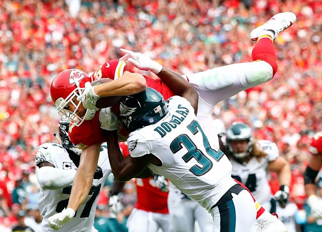 <p>Tight end Travis Kelce #87 of the Kansas City Chiefs leaps over defenders into the end zone for a touchdown during the 2nd half of the game against the Philadelphia Eagles at Arrowhead Stadium on September 17, 2017 in Kansas City, Missouri. (Photo by Jamie Squire/Getty Images) </p>