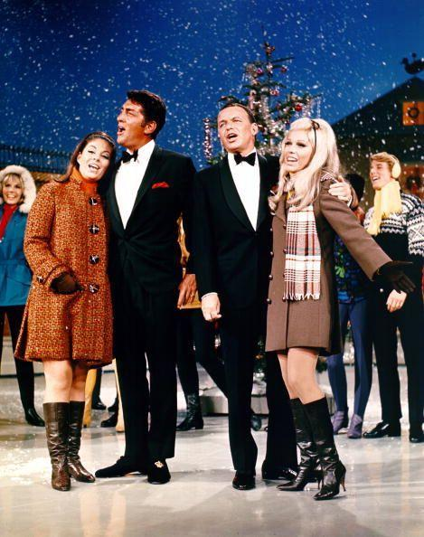 <p>Frank Sinatra joined his longtime friend, Dean Martin, for a taping of a holiday special in 1967. Both crooners looked polished in tuxedos—Martin added a festive red pocket square—and were joined by their daughters onstage. </p>