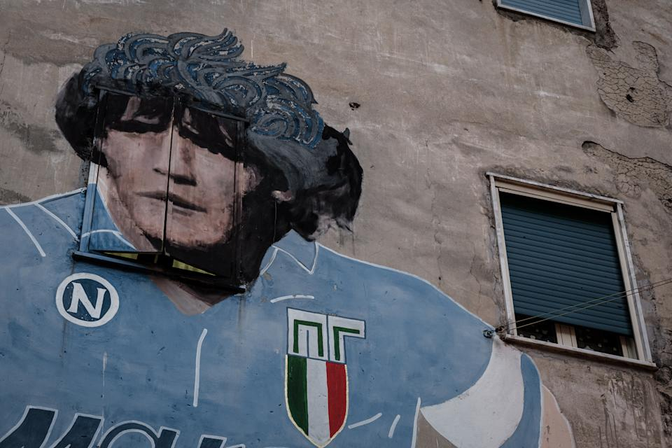 The mural of Argentinean footballer Diego Armando Maradona in the Quartieri Spagnoli in the metropolitan city of Naples during the inauguration of the votive chapel dedicated to the same footballer on February 6, 2020. (Photo by Manuel Dorati/NurPhoto via Getty Images)