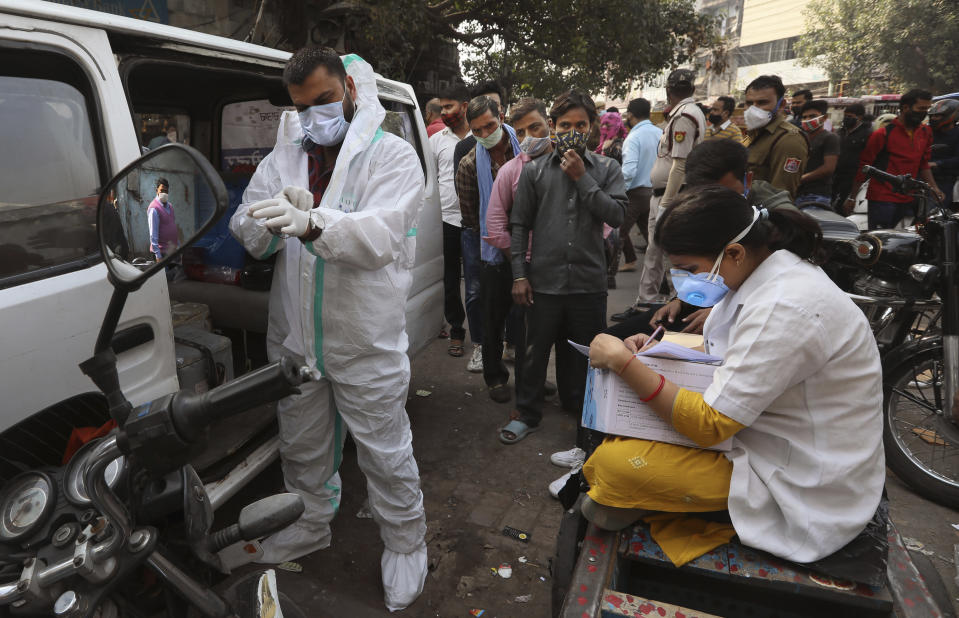A health worker gears up to collect samples to test for COVID-19 in New Delhi, India, Thursday, Nov. 19, 2020. Nevertheless the country's new daily cases have seen a steady decline for weeks now and the total number of cases represents 0.6% of India's 1.3 billion population. (AP Photo/Manish Swarup)