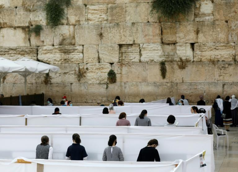 In Jerusalem, special measures have been put in place to ensure those praying at the Western Wall keep a safe distance from each other (AFP Photo/MENAHEM KAHANA)