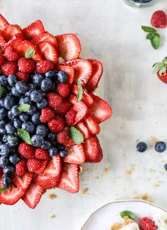 Get the No-Bake Cheesecake Triple Berry Star Tart recipe from How Sweet Eats