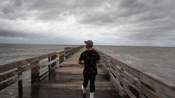 PHOTO: Bruce Laden walks along a pier to find a spot to fish from before the possible arrival of Hurricane Sally, Sept. 15, 2020, in Biloxi, Mississippi. (Joe Raedle/Getty Images)