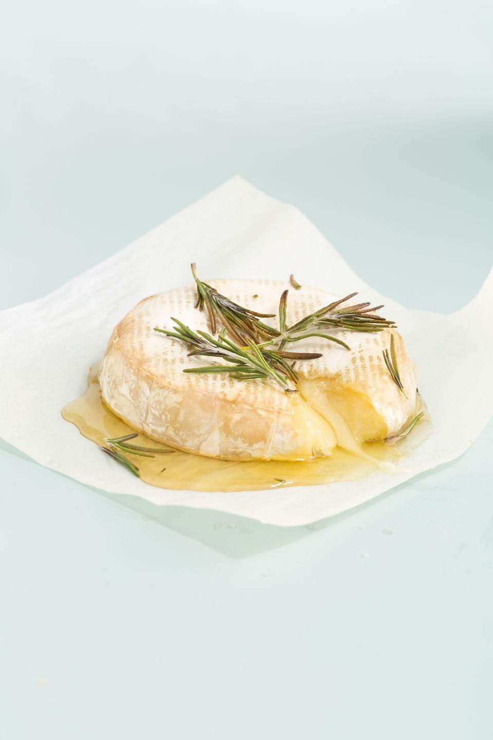 """<p>You really can't top melted, gooey cheese.</p><p>Get the recipe from <a href=""""https://www.delish.com/cooking/recipe-ideas/recipes/a44697/baked-brie-honey-rosemary/"""" rel=""""nofollow noopener"""" target=""""_blank"""" data-ylk=""""slk:Delish"""" class=""""link rapid-noclick-resp"""">Delish</a>.</p>"""