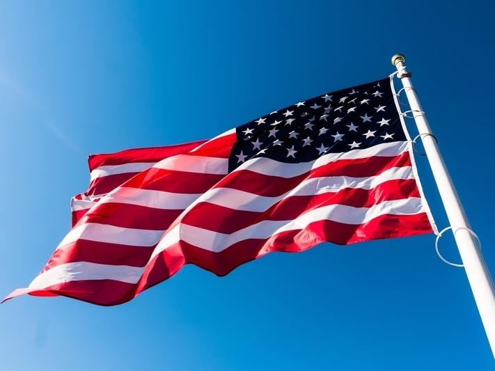 The American flag should never touch the ground and should be retired if it's faded or tattered, according to the U.S. Flag Code.