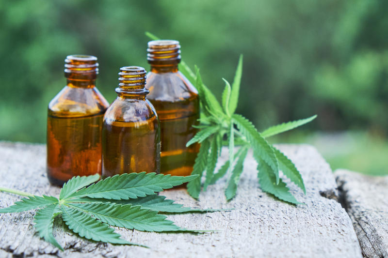 Marijuana leaves and bottles of derivative product