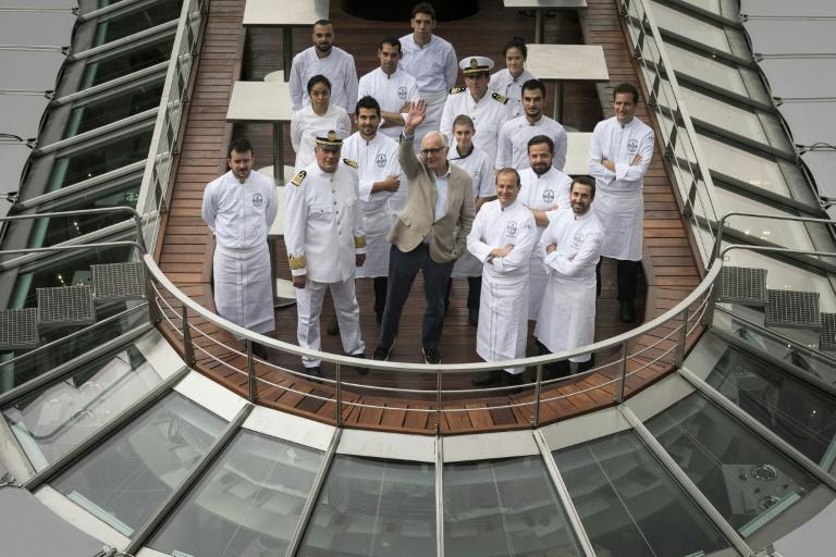 French chef Alain Ducasse (C) has a total of 21 Michelin stars