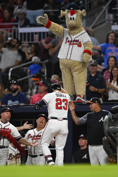 Atlanta Braves' Adam Duvall (23) celebrates as he enters the dugout after hitting a two-run home run during the seventh inning of a baseball game against the San Francisco Giants, Saturday, Sept. 21, 2019, in Atlanta. (AP Photo/John Amis)