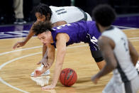 Northwestern guard Ty Berry (3) battles for a loose ball against Chicago State forward Kalil Whitehead during the second half of an NCAA college basketball game in Evanston, Ill., Saturday, Dec. 5, 2020. (AP Photo/Nam Y. Huh)