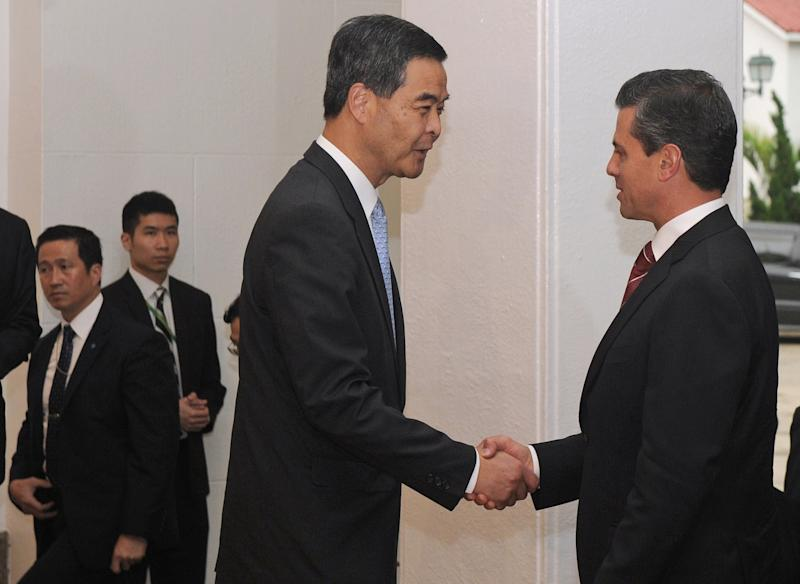 Hong Kong Chief Executive Leung Chun-Ying, left, shakes hands with Mexican President Enrique Pena Nieto, right, before their talks at Government House in Hong Kong on Friday April 5, 2013. Enrique Pena Nieto is on a trip aimed at deepening economic ties and widening relations with the Asia-Pacific region. (AP Photo / Dale de la Rey)