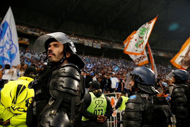 Soccer Football - Europa League Final - Olympique de Marseille vs Atletico Madrid - Groupama Stadium, Lyon, France - May 16, 2018 Police in riot gear inside the stadium during the match REUTERS/John Sibley