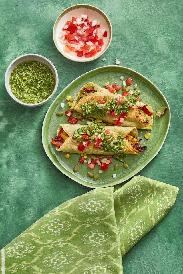 "<p>The best part of these enchiladas is the mouthwatering salsa, made with cilantro, jalapeño, sugar, lime juice, and pumpkin seeds.  </p><p><strong><a href=""https://www.womansday.com/food-recipes/food-drinks/recipes/a60792/enchiladas-with-pumpkin-seed-salsa-recipe/"" target=""_blank"">Get the recipe.</a></strong></p>"