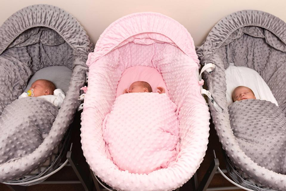 The triplets get through 150 nappies every week [Photo: Caters]