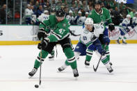 Dallas Stars right wing Alexander Radulov (47) moves to take control of the puck in front of Vancouver Canucks center Jay Beagle (83) in the second period of an NHL hockey game in Dallas, Tuesday, Nov. 19, 2019. (AP Photo/Tony Gutierrez)