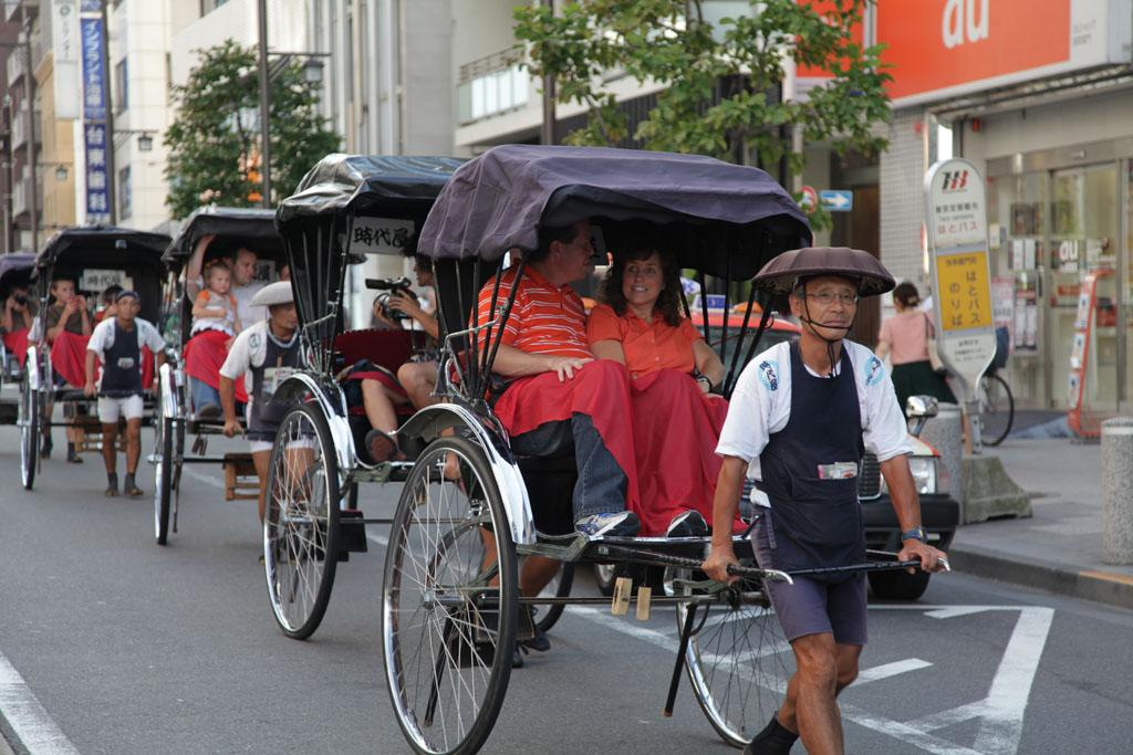 Duggars go for a ride down the street in rickshaws.