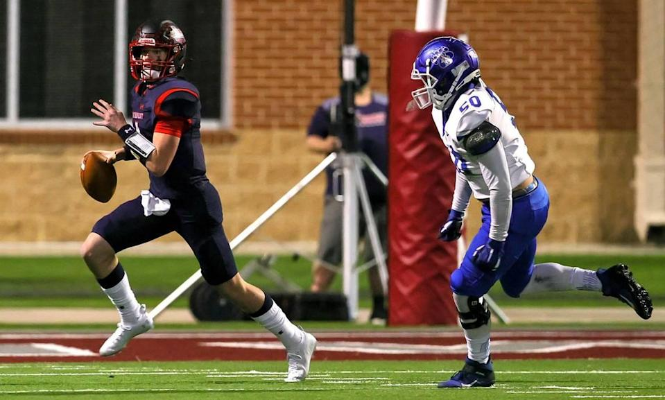 Northwest quarterback Jake Strong (4) tries to scrambles past Brewer defensive lineman Robert Fick (50) during the first half of a high school football game, November 19, 2020 played at Northwest ISD Stadium in Justin, Tx. (Steve Nurenberg Special to the Star-Telegram)