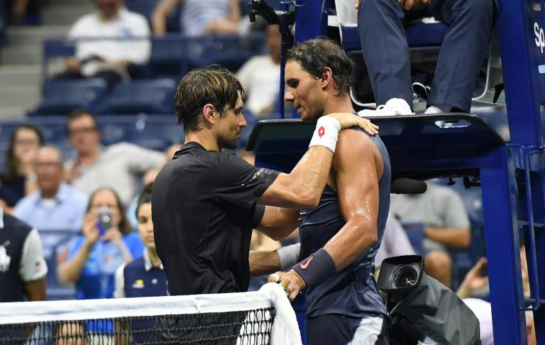 Old pals act: Rafael Nadal and David Ferrer embrace