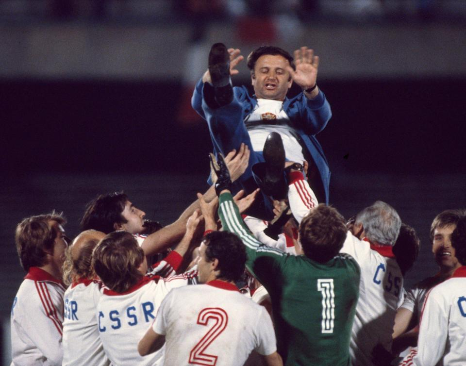 Venglos is thrown in the air by his Czechoslovakia players after their third-place play-off victory against Italy in Naples at the 1980 European Championship - Eamonn McCabe/Popperfoto via Getty Images