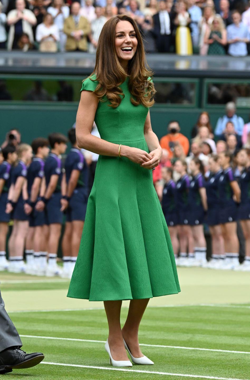 """<p>The Duchess coordinated with Wimbledon's grass courts when she <a href=""""https://www.townandcountrymag.com/society/tradition/a36987867/kate-middleton-prince-william-wimbledon-ladies-final-photos-2021/"""" rel=""""nofollow noopener"""" target=""""_blank"""" data-ylk=""""slk:attended the ladies' singles final"""" class=""""link rapid-noclick-resp"""">attended the ladies' singles final</a>. To present the trophy, Kate chose a Kelly green, pleated Emilia Wickstead dress and white pointed-toe pumps. </p>"""
