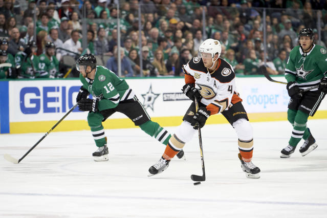Anaheim Ducks defenseman Cam Fowler (4) controls the puck against the Dallas Stars during the second period of an NHL hockey game Saturday, Oct. 13, 2018, in Dallas. (AP Photo/Cooper Neill)