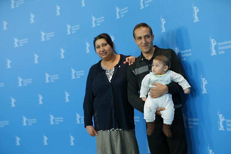 From left, actors Senada Alimanovic, Nazif Mujic and baby Danis pose for the photo call of the film An Episode in the Life of an Iron Picker at the 63rd edition of the Berlinale, International Film Festival in Berlin, Wednesday, Feb. 13, 2013. (AP Photo/Markus Schreiber)