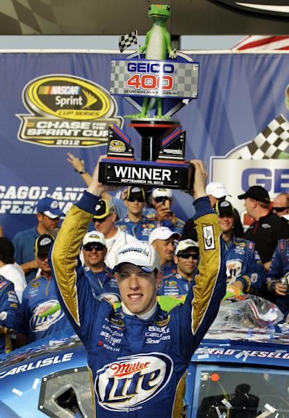 Brad Keselowski lifts the trophy in victory lane after winning the NASCAR Sprint Cup Series auto race at Chicagoland Speedway in Joliet, Ill., Sunday, Sept. 16, 2012. (AP Photo/Nam Y. Huh)