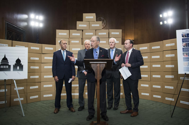 Republican Senate Judiciary Committee members standing with boxes representing roughly 1 million pages of documents on Supreme Court nominee Brett Kavanaugh. (Tom Williams via Getty Images)